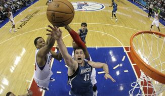Minnesota Timberwolves' Kevin Love (42) battles for a rebound with Philadelphia 76ers' Daniel Orton, left, and Lavoy Allen during the second half of an NBA basketball game, Monday, Jan. 6, 2014, in Philadelphia. Minnesota won 126-95. (AP Photo/Matt Slocum)