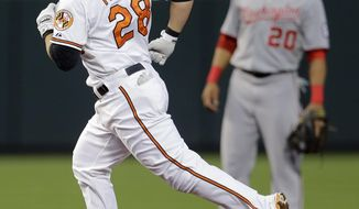 Baltimore Orioles' Steve Pearce rounds the bases past Washington Nationals shortstop Ian Desmond after hitting a solo home run in the first inning of an interleague baseball game, Thursday, July 10, 2014, in Baltimore. (AP Photo/Patrick Semansky)