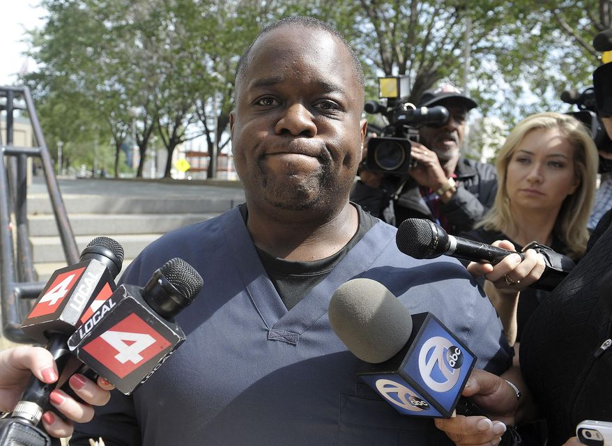 FILE - In this June 27, 2014 file photo, Charles Bothuell IV leaves the Frank Murphy Hall of Justice in Detroit, Mich., after a court hearing for his wife, Monique Dillard-Bothuell.  His 12-year-old son found in his basement after a widely publicized 11-day search was abused by his father and stepmother and forced to rise before dawn for intense workouts of 100 pushups and even more situps, according to Michigan's child-welfare agency. Detailed allegations of physical and mental abuse were filed this week as the state tries to terminate the parental rights of Charlie Bothuell IV. No criminal charges have been filed. (AP Photo/Detroit News, Clarence Tabb, Jr)  DETROIT FREE PRESS OUT; HUFFINGTON POST OUT