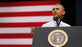 President Barack Obama speaks on the economy at the Paramount Theatre in Austin, Texas, Sunday, July 10, 2014. (AP Photo/The Dallas Morning News, Kye R. Lee, Pool)