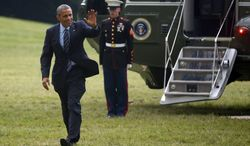 President Barack Obama waves as he steps off the Marine One helicopter on the South Lawn at the White House in Washington, Thursday, July 10, 2014, after he returned from a three-day trip to Colorado and Texas. (AP Photo/Charles Dharapak)