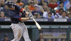 Boston Red Sox's Christian Vazquez hits an RBI ground-rule double against the Houston Astros in the fourth inning of a baseball game Friday, July 11, 2014, in Houston. (AP Photo/Pat Sullivan)