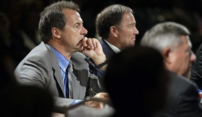 Montana Gov. Steve Bullock, left, and Utah Gov. Gary Richard Herbert, center, listen as Vice President Joe Biden speaks at the National Governors Association convention Friday, July 11, 2014, in Nashville, Tenn. (AP Photo/Mark Humphrey)