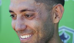 Seattle Sounders' Clint Dempsey talks to reporters following a training session, Friday, July 11, 2014, in Tukwila, Wash. It was Dempsey's first day back training with the Sounders after his time with the U.S. Men's National Team at the World Cup in Brazil. (AP Photo/Ted S. Warren)