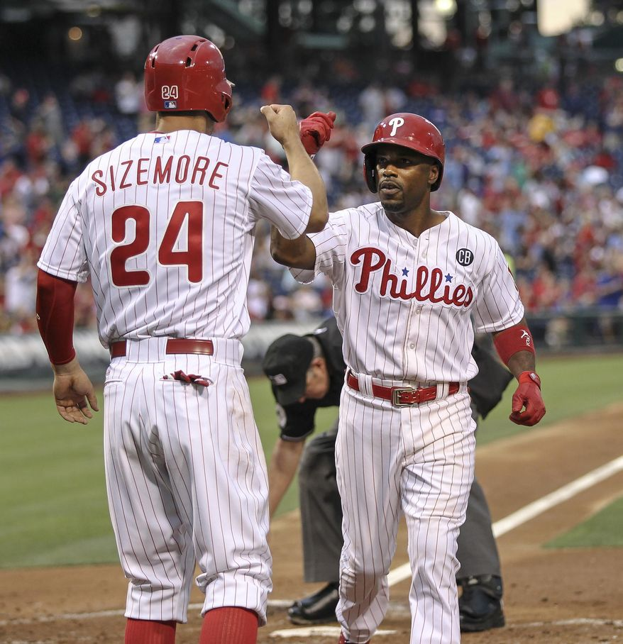 Philadelphia Phillies' Grady Sizemore, left, greets Jimmy Rollins at home plate after his two-run home run against the Washington Nationals during the third inning of a baseball game in Philadelphia, Friday, July 11, 2014. (AP Photo/Philadelphia Daily News, Steven M. Falk)