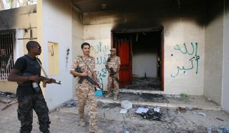 In this Sept. 14, 2012, file photo, Libyan military guards check one of the U.S. consulate's burned buildings in Benghazi, after a deadly attack on Tuesday, Sept. 11, 2012, that killed four Americans. (AP Photo/Mohammad Hannon, File)