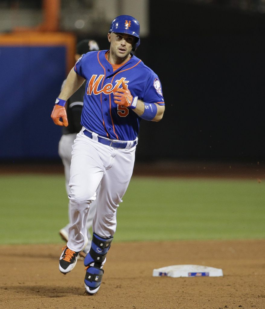New York Mets' David Wright rounds the bases after hitting a two-run home run against the Miami Marlins in the fifth inning of a baseball game, Friday, July 11, 2014, in New York. Wright was 4 for 4 in the Mets' 7-1 win. (AP Photo/Julie Jacobson)