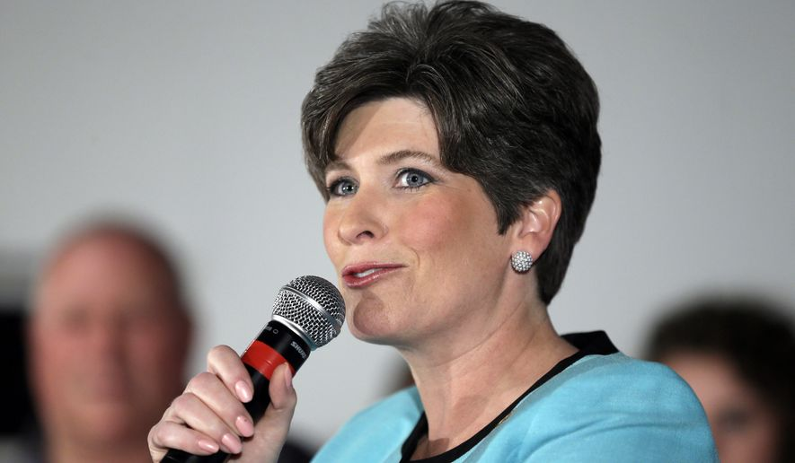 FILE - This June 3, 2014 file photo show Iowa Republican Senate candidate, State Sen. Joni Ernst speaking in Des Moines, Iowa. Ernst will take a break from campaigning for two weeks to take part in active duty training for the Iowa National Guard. But before lacing up her boots, Ernst has recorded the Republicans' national radio address. (AP Photo/Charlie Neibergall, File)