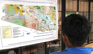 FILE - In this Aug. 9, 2012 file photo, a young Mexican boy, looks at a map of the recorded Arizona border deaths in a well known immigrant shelter in Nogales, Mexico. A major U.S. effort to discourage repeated attempts by immigrants to enter the country illegally by flying and busing them into Mexico hundreds of miles away from where they were caught, but government statistics and interviews with migrants in Mexican shelters suggest the dislocation is rarely a deterrent, especially for immigrants with spouses, children and roots in the U.S. (AP Photo/Ross D. Franklin, File)