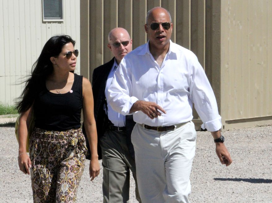** FILE ** Department of Homeland Security director Jeh Johnson, right, walks to a podium after finishing a tour of the Residential Detention Facility inside the Federal Law Enforcement Training Center in Artesia, N.M. on Friday, July 11, 2014. (AP Photo/Pool, El Paso Times, Rudy Gutierrez)
