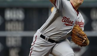 Washington Nationals' Jordan Zimmermann pitches during the first inning of a baseball game against the Philadelphia Phillies, Friday, July 11, 2014, in Philadelphia. (AP Photo/Matt Slocum)