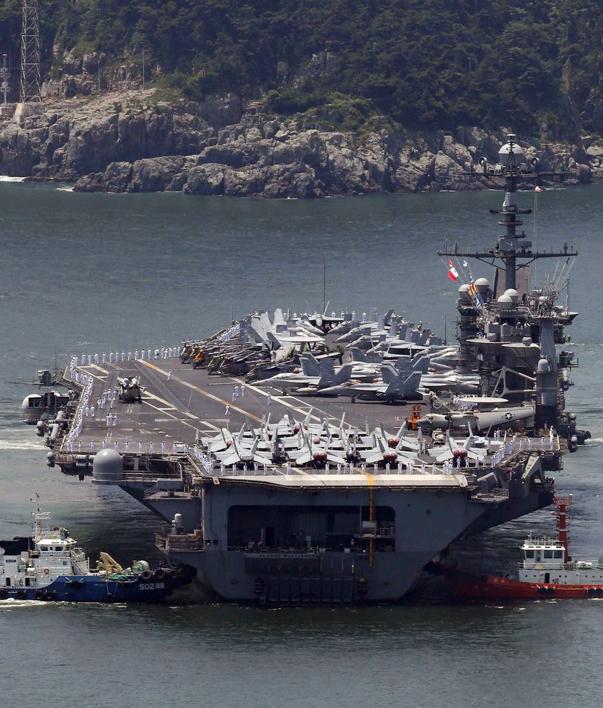 ** FILE ** The nuclear-powered aircraft carrier USS George Washington is escorted into a navy port in Busan, South Korea, Friday, July 11, 2014. The U.S. carrier is in South Korea to join the ongoing South Korea and U.S. joint military drill. (AP Photo/Yonhap, Jo Jung-ho)