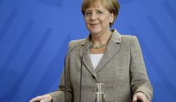 German Chancellor Angela Merkel smiles during a joint news conference with the Prime Minster of Moldova Iurie Leanca as part of a meeting at the chancellery in Berlin, Germany, Thursday, July 10, 2014. (AP Photo/Michael Sohn)