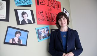 Sandra Fluke poses for a photograph at her campaign office in Los Angeles in this July 1, 2014, file photo. (AP Photo/Nick Ut) ** FILE **