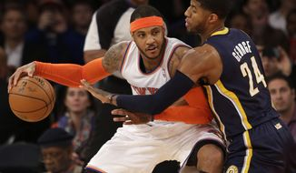 FILE - In this March 19, 2014, file photo, New York Knicks' Carmelo Anthony, left, tries to move around Indiana Pacers' Paul George during the first half of an NBA basketball game at Madison Square Garden in New York. Two people with knowledge of the details say that Anthony has informed the Knicks he intends to become a free agent. (AP Photo/Seth Wenig, File)