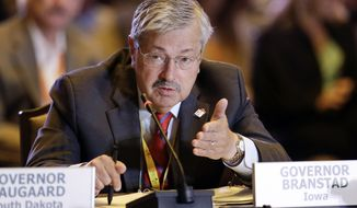 Iowa Gov. Terry Branstad asks a question during a meeting of the Health and Human Services Committee at the National Governors Association convention Saturday, July 12, 2014, in Nashville, Tenn. (AP Photo/Mark Humphrey)