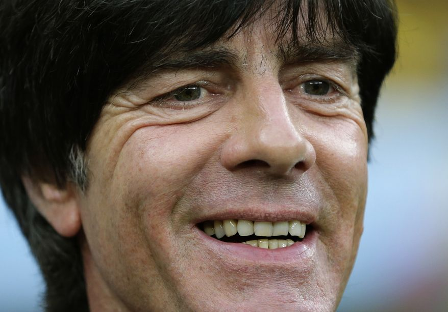 Germany's head coach Joachim Loew smiles before the World Cup semifinal soccer match between Brazil and Germany at the Mineirao Stadium in Belo Horizonte, Brazil, Tuesday, July 8, 2014. (AP Photo/Matthias Schrader)