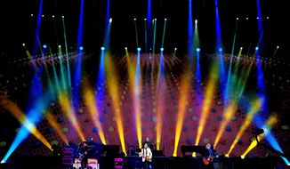 """Paul McCartney performs for the first time in North Dakota, Saturday, July 12, 2014, during his """"Out There"""" tour stop at the Fargodome in Fargo, N.D. (AP Photo/Bruce Crummy)"""