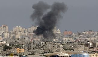 Smoke rises following an Israeli strike on Gaza, seen from the Israel-Gaza border, Saturday, July 12, 2014. Israeli airstrikes overnight targeting Hamas in Gaza hit a mosque its military says concealed the militant group's weapons, in an offensive that showed no signs of slowing down. Israel launched its campaign five days ago to stop relentless rocket fire on its citizens. While there have been no fatalities in Israel, Palestinian officials said overnight attacks raised the death toll there to over 120, with more than 920 wounded. (AP Photo/Lefteris Pitarakis)
