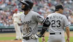 Chicago White Sox's Alexei Ramirez (10) walks to the dugout with a back injury in the fourth inning of a baseball game against the Cleveland Indians Saturday, July 12, 2014, in Cleveland. The White Sox won 6-2. (AP Photo/Mark Duncan)