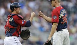 U.S. catcher Justin O'Conner, left, celebrates with pitcher Noah Syndergaard after the team's 3-2 victory over the World team in the All-Star Futures baseball game, Sunday, July 13, 2014, in Minneapolis. (AP Photo/Jeff Roberson)
