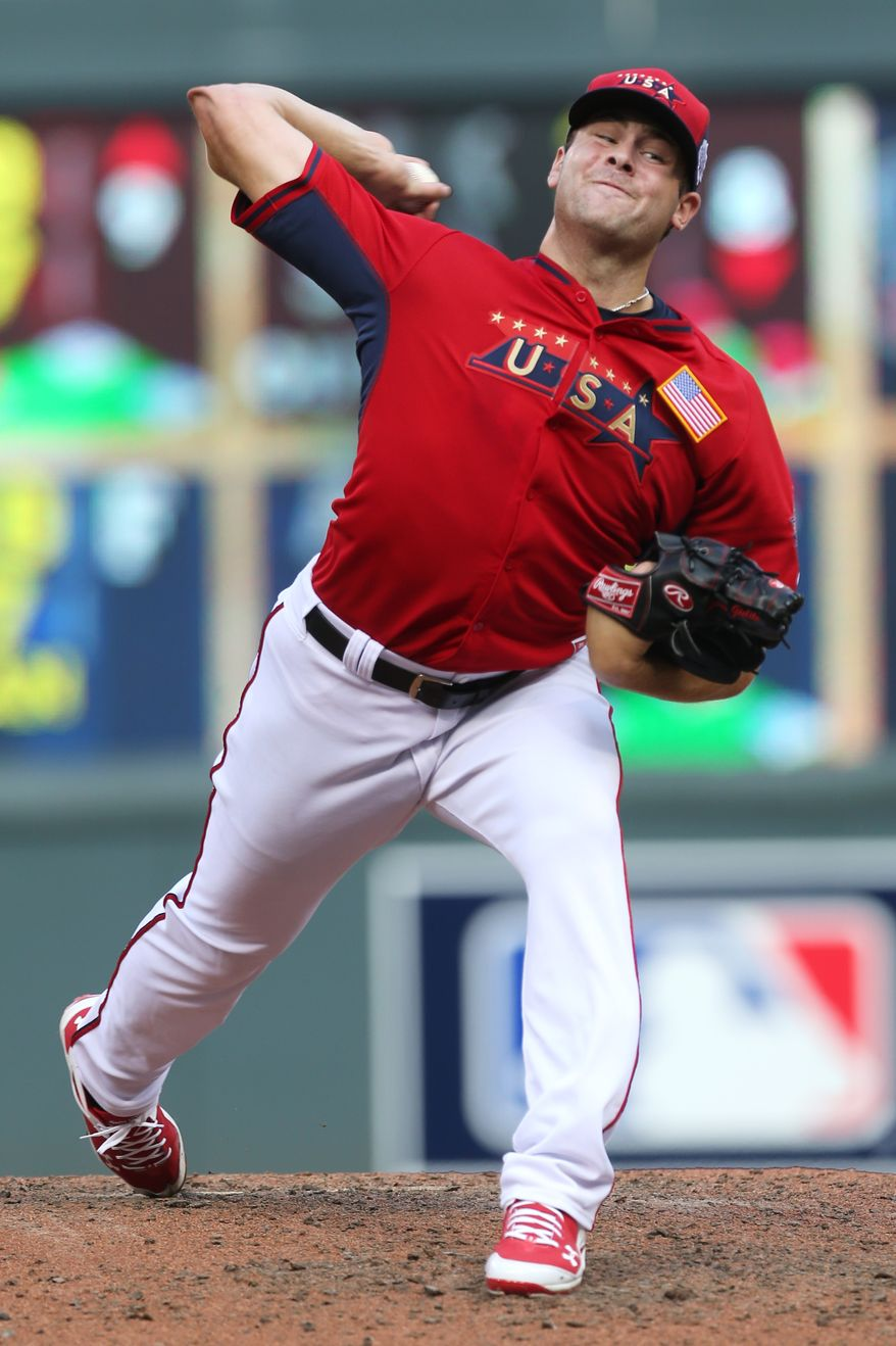 United States' pitcher Lucas Giolito throws a pitch during the fifth inning of the All-Star Futures baseball game against the World Team, Sunday, July 13, 2014, in Minneapolis. (AP Photo/Jim Mone)