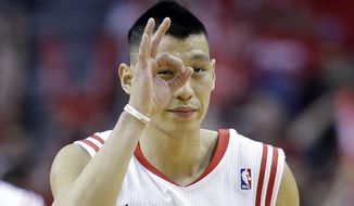 Houston Rockets' Jeremy Lin reacts after making a three-point basket during the first half in Game 1 of an opening-round NBA basketball playoff series against the Portland Trail Blazers, Sunday, April 20, 2014, in Houston. (AP Photo/David J. Phillip)