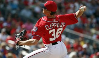 Washington Nationals relief pitcher Tyler Clippard (36) throws during the eighth inning of a baseball game against the New York Mets at Nationals Park Sunday, May 18, 2014, in Washington. The Nationals won 6-3. (AP Photo/Alex Brandon)
