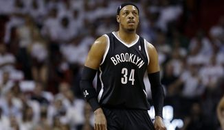 Brooklyn Nets' Paul Pierce (34) walks on the court in the first half of Game 1 in an Eastern Conference semifinal basketball game against the Miami Heat, Tuesday, May 6, 2014, in Miami.  (AP Photo/Lynne Sladky)