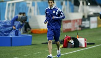 Argentina's Angel di Maria jogs during a training session one day before their World Cup semifinal soccer match against Netherlands at Itaquerao Stadium in Sao Paulo, Brazil, Tuesday, July 8, 2014. (AP Photo/Victor R. Caivano)