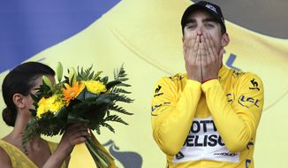 France's Tony Gallopin, wearing the overall leader's yellow jersey, celebrates on the podium of the ninth stage of the Tour de France cycling race over 170 kilometers (105.6 miles) with start in Gerardmer and finish in Mulhouse, France, Sunday, July 13, 2014. (AP Photo/Christophe Ena)