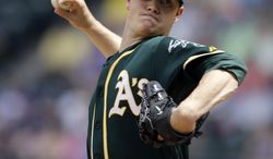 Oakland Athletics starting pitcher Sonny Gray throws against the Seattle Mariners in the second inning of a baseball game Sunday, July 13, 2014, in Seattle. (AP Photo/Elaine Thompson)