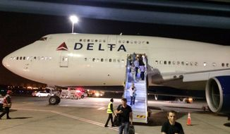 """** FILE ** In this photo provided by Michael Simon, a New York-bound Delta Air Lines plane is seen at Ben Gurion Airport in Tel Aviv, Israel, after an emergency Sunday, July 13, 2014. The flight returned safely to Tel Aviv about two hours after it left for John F. Kennedy International Airport in New York after flaps on the jumbo jet failed to retract properly on takeoff, the airline said. Delta spokeswoman Jennifer Martin said the crew made the emergency landing """"out of an abundance of caution."""" (AP Photo/Michael Simon)"""
