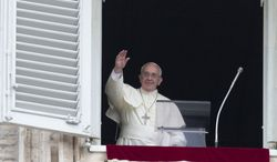 Pope Francis waves as he arrives for the Angelus prayer he delivers from the studio window overlooking St. Peter square at the Vatican, Sunday, July 13, 2014. Pope Francis has led tens of thousands of people in St. Peterís Square in unannounced, silent prayer for an end to the warfare in the Mideast. Francis called for insistent prayers for peace in the Holy Land during his Sunday window appearance to pilgrims and tourists. (AP Photo/Alessandra Tarantino)