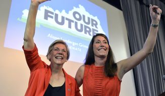 FILE - In this June 29, 2014 file photo, U.S. Sen. Elizabeth Warren, D-Mass., left, and Kentucky Democratic Senatorial candidate Alison Lundergan Grimes wave to supporters at at rally in Louisville, Ky. Warren is quickly becoming a top Democrat fund-raising and campaigning powerhouse. Since March, she has stumped for candidates in Ohio, Minnesota, Oregon, Washington and Kentucky and has trips planned in July for West Virginia and Michigan. It's a hefty schedule for a freshman senator who not long ago was teaching law at Harvard.  (AP Photo/Timothy D. Easley, File)