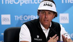 Phil Mickelson of the US talks to the media during his press conference at Royal Liverpool Golf Club prior to the start of the British Open Golf Championship, in Hoylake, England, Monday, July 14, 2014. The 2014 Open Championship starts on Thursday, July 17. (AP Photo/Scott Heppell)