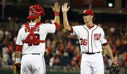 Washington Nationals catcher Wilson Ramos (40) celebrates with relief pitcher Tyler Clippard after a baseball game against the Philadelphia Phillies at Nationals Park Tuesday, June 3, 2014, in Washington. The Nationals won 7-0. (AP Photo/Alex Brandon)