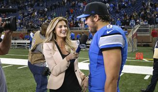 Fox Sports reporter Erin Andrews, left, interviews Detroit Lions quarterback Matthew Stafford after an NFL football game against the Green Bay Packers at Ford Field in Detroit, Thursday, Nov. 28, 2013. (AP Photo/Paul Sancya)