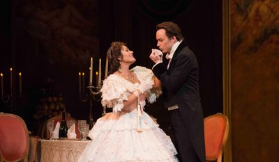 "In this June 29, 2014 photo provided by the San Francisco Opera, soprano Ailyn Perez and her husband, tenor Stephen Costello, rehearse for Verdi's ""La Traviata"" at the War Memorial Opera House. The couple perform together whenever they can, although their careers often have them continents apart. (AP Photo/San Francisco Opera/Kristen Loken)"