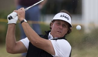 Phil Mickelson of the US plays out of a bunker by the 2nd green during a practice round at Royal Liverpool Golf Club prior to the start of the British Open Golf Championship, in Hoylake, England, Monday, July 14, 2014. The 2014 British Open Championship starts on Thursday, July 17. (AP Photo/Jon Super)