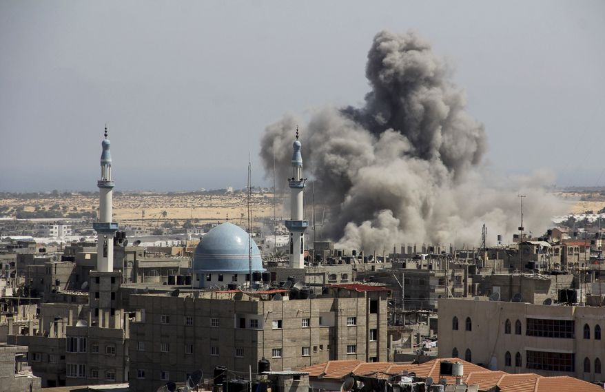 FILE - In this file photo taken July 9, 2014, an Israeli missile hits an area in Rafah, southern Gaza Strip. Israel says its punishing air assault on Hamas militants, their property and their weaponry has delivered a devastating blow to the Islamic militant group. Yet rocket fire at Israel has continued almost unabated. (AP Photo/Hatem Ali, File)