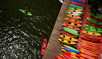 The popularity of kayaking and other outdoors sports help some cities recover from the recession. (Andrew Harnik/The Washington Times)