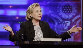 "Former U.S. Secretary of State Hillary Rodham Clinton gestures while speaking to host Jon Stewart during a taping of ""The Daily Show with Jon Stewart,"" Tuesday, July 15, 2014, in New York.  (AP Photo/Frank Franklin II)"