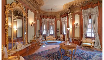 The front parlor of the Heurich House Museum, a bright room with ornate wood carvings and gold accents. (Photos by Bruce M. White, courtesy Heurich House)