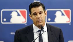 Former major league outfielder Billy Bean speaks during a news conference at baseball's All-Star game, Tuesday, July 15, 2014, in Minneapolis. Major League Baseball has appointed Bean, who came out as gay after his playing career, to serve as a consultant in guiding the sport toward greater inclusion and equality. (AP Photo/Paul Sancya)