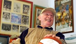 """FILE - In this March 21, 2001, file photo, Red Klotz, 80, owner of full-time Globetrotters' opponent the New York Nationals, smiles inside his office at his home in Margate, N.J. The basketball barnstormer who owned the Washington Generals and other teams that lost thousands of games to the Harlem Globetrotters died Monday, July 14, 2014. Louis """"Red"""" Klotz was 93. (AP Photo/Chris Polk, File)"""