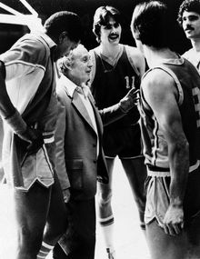"""Louis """"Red"""" Klotz, owner-coach-player of the Washington Generals, in suit, confers with team members during a game against the Harlem Globetrotters, Feb. 22, 1980, at the University of Tennessee's Stokely Athletic Center in Knoxville.  The last time the Generals beat the Globetrotters was in 1971.  """"When you beat them,"""" says Klotz, """"It's like killing Santa Claus.""""  From left to right:  Sam Sawyer, Klotz, Dick Taylor and Harold Jackson.  (AP Photo)"""