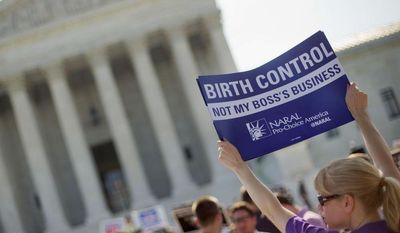 Demonstrators outside the Supreme Court on the day the court decided in the Hobby Lobby case to relieve businesses with religious objections of their obligation to pay for women's contraceptives.  (AP Photo/Pablo Martinez Monsivais, File)