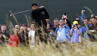 Tiger Woods of the US plays a shot off the 5th tee during a practice round ahead of the British Open Golf championship at the Royal Liverpool golf club, Hoylake, England, Tuesday July 15, 2014. The British Open starts on Thursday July 17. (AP Photo/Peter Morrison)