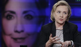"""Former U.S. Secretary of State Hillary Rodham Clinton gestures while speaking to host Jon Stewart during a taping of """"The Daily Show with Jon Stewart,"""" Tuesday, July 15, 2014, in New York.  (AP Photo/Frank Franklin II)"""